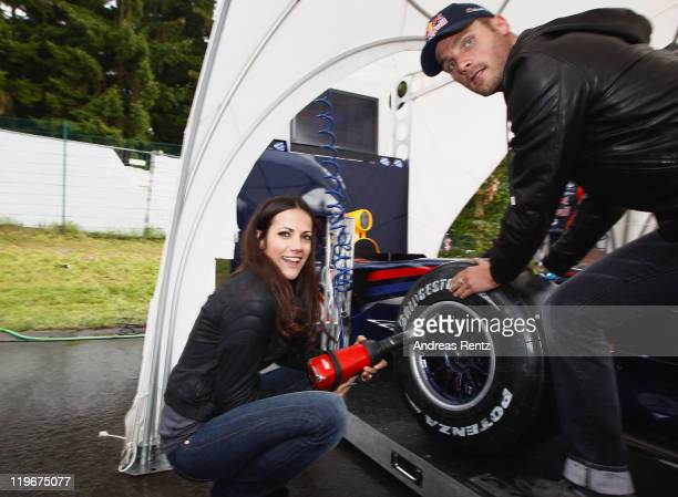 Actress Bettina Zimmermann and DTM driver Martin Tomczyk attend the Red Bull On Track event at the Driving Safety Center on July 23 2011 in Nuerburg...