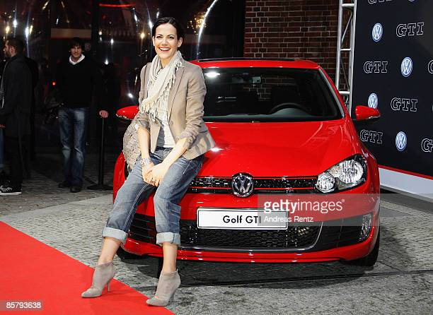 Actress Bettina Zimmermann poses with the new Golf GTI during the premiere of the Volkswagen Golf GTI at 'ewerk' on April 3 2009 in Berlin Germany