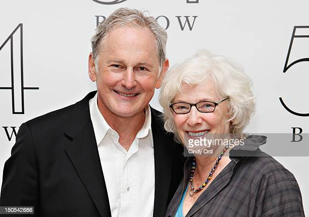 Actress Betty Buckley poses with actor Victor Garber backstage following his performance at 54 Below on August 20 2012 in New York City
