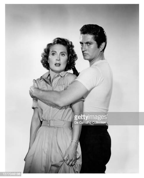 Actress Betty Garrett as 'Linda Atlas' and John Drew Barrymore as 'Jess Reber' holding a gun in a publicity shot from the movie 'The Shadow on the...
