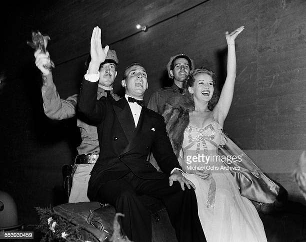 Actress Betty Grable and husband actor Jackie Coogan celebrate as they attend an event in Los Angeles California