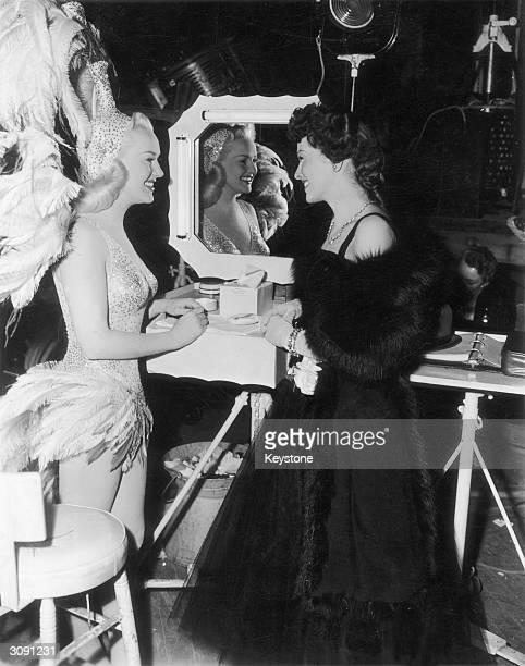 Actress Betty Grable and Trudy Marshall on the set of the musical 'The Dolly Sisters' in a Twentieth Centuy Fox studio.