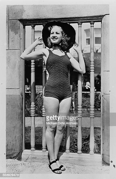 Actress Betty Grable poses in a swim suit and hat in Los Angeles California