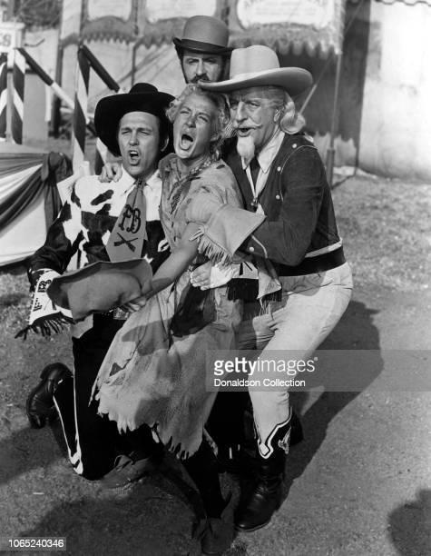 Actress Betty Hutton Howard Keel Louis Calhern Keenan Wynn in a scene from the movie Annie Get Your Gun