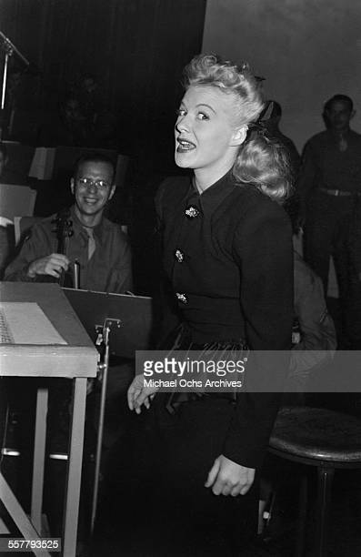 Actress Betty Hutton poses as she sings in the studio in Los Angeles California
