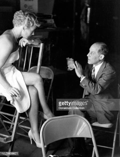 Actress Betty Hutton poses for a portrait with a man in circa 1958