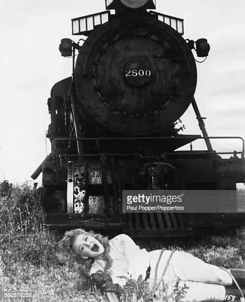 Actress Betty Hutton screams she lies tied up on rail tracks in front of a train as she appears in the film 'The Perils of Pauline' 1947
