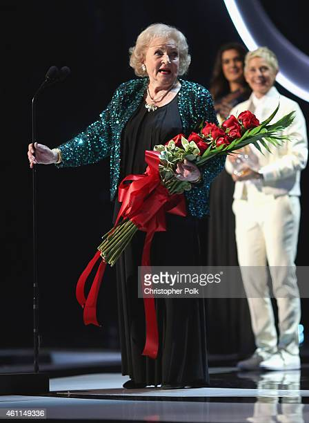 Actress Betty White accepts the award for Favorite TV Icon from tv personality Ellen DeGeneres onstage during The 41st Annual People's Choice Awards...