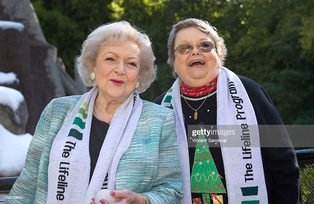 Actress Betty White and 'Bucket List' contest winner Leslie Scott attend the 'White Hot' holiday event at Los Angeles Zoo on December 11, 2012 in Los Angeles, California.