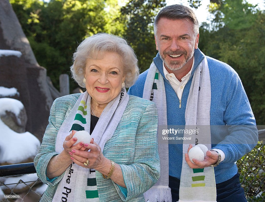 Actress Betty White and President and CEO Scott Page attend the 'White Hot' holiday event at Los Angeles Zoo on December 11, 2012 in Los Angeles, California.