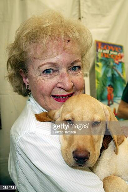 Actress Betty White meets a puppy at the 9th annual 'Safari Brunch' at the Playboy Mansion to benefit the Wildlife Waystatio Country's Premier wild...