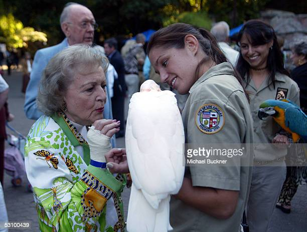 Actress Betty White pets a Moluccan Cockatoo during the 25th annual Beastly Ball at the Los Angeles Zoo on June 18 2005 in Los Angeles California