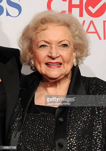 """Actress Betty White poses with Favorite Cable TV Comedy Award for """"Hot in Cleveland"""" in the press room during the 2012 People's Choice Awards at..."""