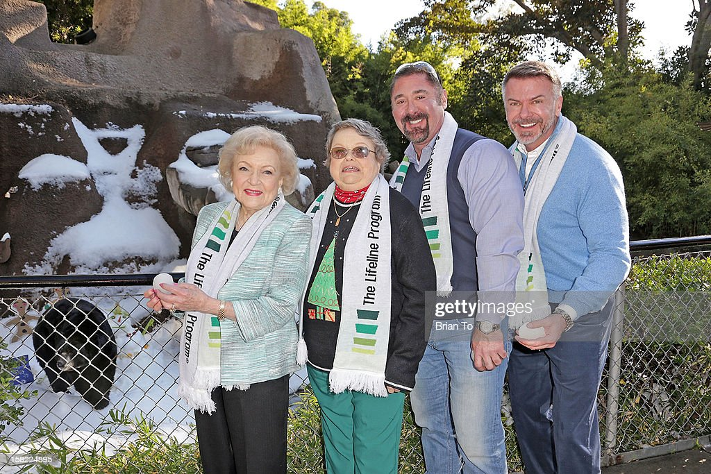 Actress Betty White, winner of The Lifeline Program's national 'Bucket List' Facebook contest Leslie Scott, SVP of Market Development & Branding Stephen Terrell, and Lifeline Program Founder & CEO Wm. Scott Page attend Betty 'White Out' Tour at The Los Angeles Zoo with The Lifeline Program at Los Angeles Zoo on December 11, 2012 in Los Angeles, California.