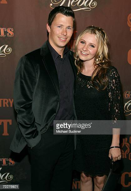 Actress Beverley Mitchell and fiance Michael Cameron arrive at the Country Music Television's CMT Giants honoring Reba McEntire at the Kodak Theatre...