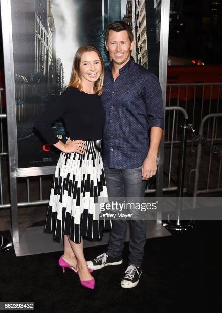 Actress Beverley Mitchell and husband Michael Cameron attend the premiere of Warner Bros Pictures' 'Geostorm' at the TCL Chinese Theatre on October...