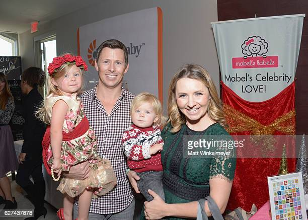 Actress Beverley Mitchell and husband Michael Cameron with their children Hutton Michael Cameron and Kenzie Cameron attend 6th Annual Santa's Secret...