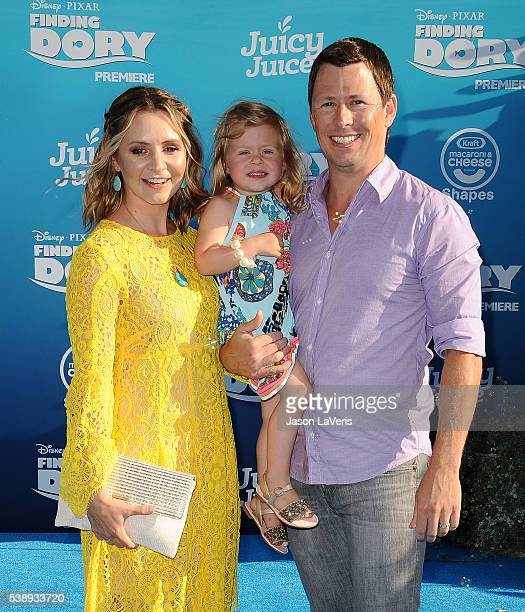 Actress Beverley Mitchell husband Michael Cameron and daughter Kenzie Cameron attend the premiere of Finding Dory at the El Capitan Theatre on June 8...