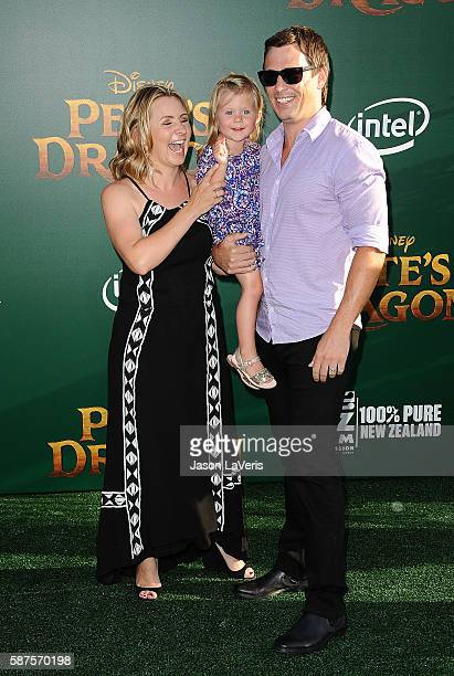Actress Beverley Mitchell husband Michael Cameron and daughter Kenzie Cameron attend the premiere of Pete's Dragon at the El Capitan Theatre on...