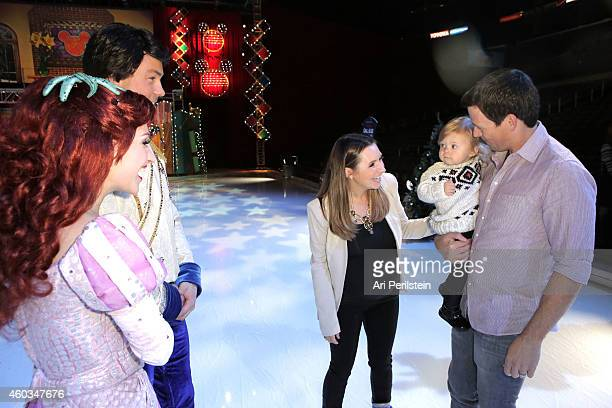 Actress Beverly Mitchell and family Michael Cameron and Kenzie Cameron attend Disney On Ice Presents Let's Celebrate Presented By Stonyfield YoKids...