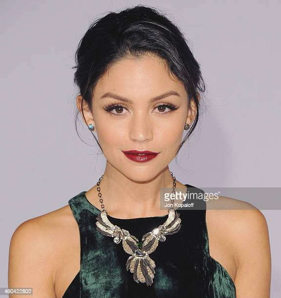 Actress Bianca A Santos arrives at the Los Angele Premiere The Hunger Games Mockingjay Part 1 at Nokia Theatre LA Live on November 17 2014 in Los...