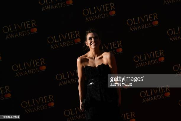 Actress Billie Piper poses on the red carpet upon arrival to attend the 2017 Laurence Olivier Awards in London on April 9 2017 / AFP PHOTO / JUSTIN...