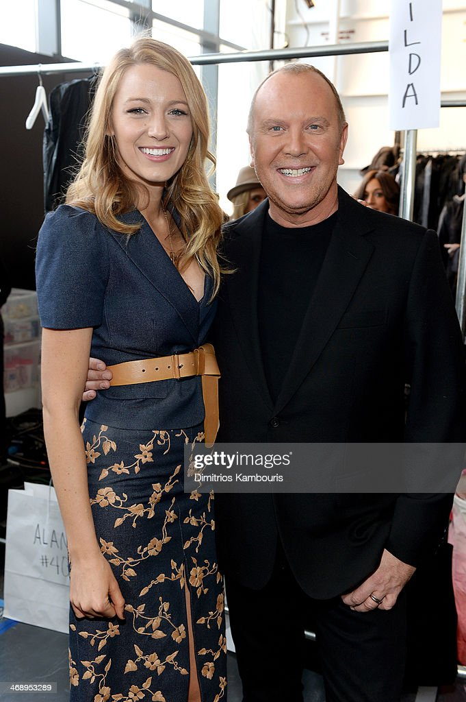 Actress Blake Lively (L) and designer Michael Kors pose backstage at the Michael Kors fashion show during Mercedes-Benz Fashion Week Fall 2014 at Spring Studios on February 12, 2014 in New York City.