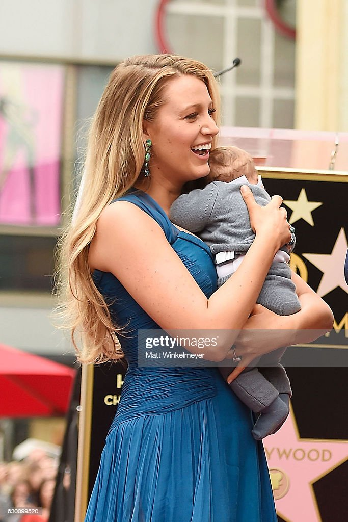 Actress Blake Lively poses for a photo with her daughter as Ryan Reynolds is honored with star on the Hollywood Walk of Fame on December 15, 2016 in Hollywood, California.