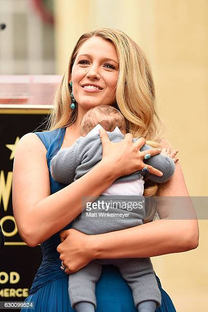 Actress Blake Lively poses for a photo with her daughter as Ryan Reynolds is honored with star on the Hollywood Walk of Fame on December 15 2016 in...