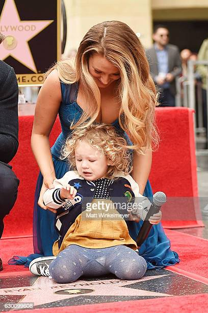 Actress Blake Lively poses for a photo with her daughter James Reynolds during a ceremony honoring Ryan Reynolds with a star on the Hollywood Walk of...