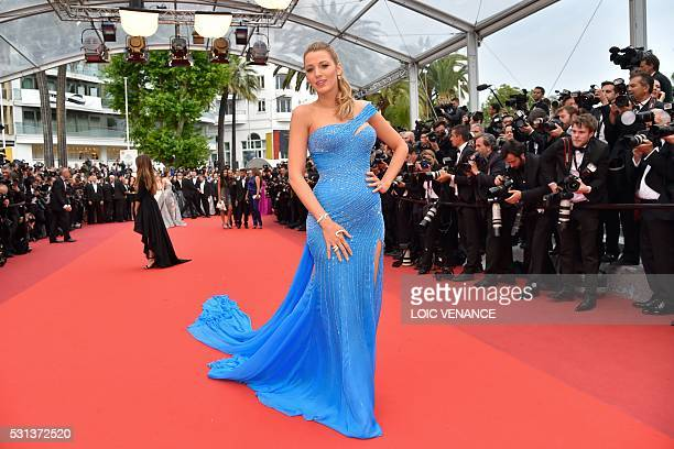 """Actress Blake Lively poses on May 14, 2016 as she arrives for the screening of the film """"The BFG"""" at the 69th Cannes Film Festival in Cannes,..."""