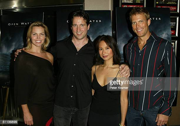 Actress Blanchard Ryan Director Chris Kentis Producer Laura Lau and Actor Daniel Travis attend the premiere of Open Water on August 2 2004 in New...