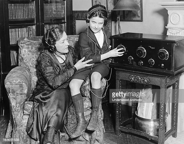 Actress Blanche Bates enjoys sharing a radio show with her son on their Eagle Neutrodyne Receiver New York New York February 12 1925