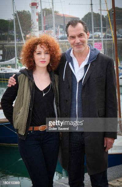 Actress Blandine Bellavoir and actor Samuel Labarthe pose during the photocall of 'Petits Meutres D'Agatha Christie' on September 12 2013 in La...