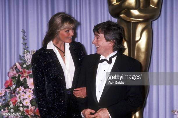 Actress Bo Derek and actor Dudley Moore attend the 61st Annual Academy Awards on March 29, 1989 at Shrine Auditorium in Los Angeles, California.