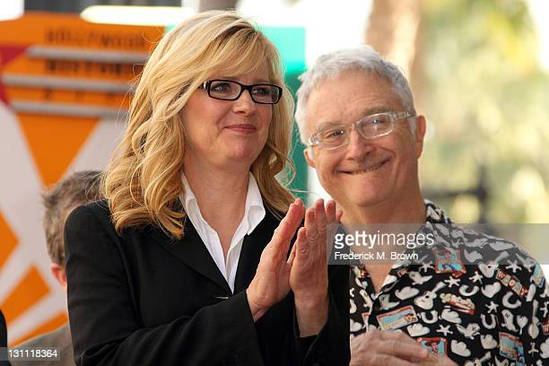 Actress Bonnie Hunt and composer Randy Newman pose for photographers during the installation ceremony for director John Lasseter's star on the...