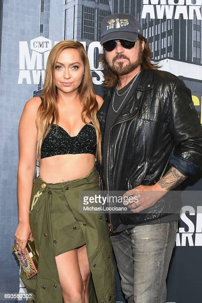 Actress Brandi Cyrus and musical artist Billy Ray Cyrus attend the 2017 CMT Music Awards at the Music City Center on June 7 2017 in Nashville...