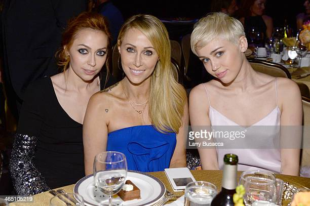 Actress Brandi Cyrus Tish Cyrus and recording artist Miley Cyrus attend the 56th annual GRAMMY Awards PreGRAMMY Gala and Salute to Industry Icons...