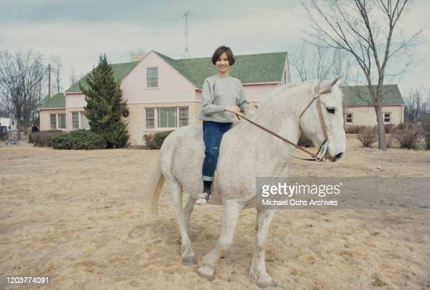 Actress Brenda Currin riding a horse in the small farming community of Holcomb Kansas during the filming of Truman Capote's nonfiction crime novel...