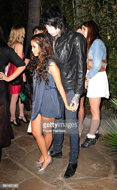 Actress Brenda Song and Trace Cyrus attent the NYLON & YouTube Young Hollywood Party at the Roosevelt Hotel on May 12, 2010 in Hollywood, California.