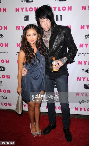 Actress Brenda Song and Trace Cyrus pose at the NYLON & YouTube Young Hollywood Party at the Roosevelt Hotel on May 12, 2010 in Hollywood, California.
