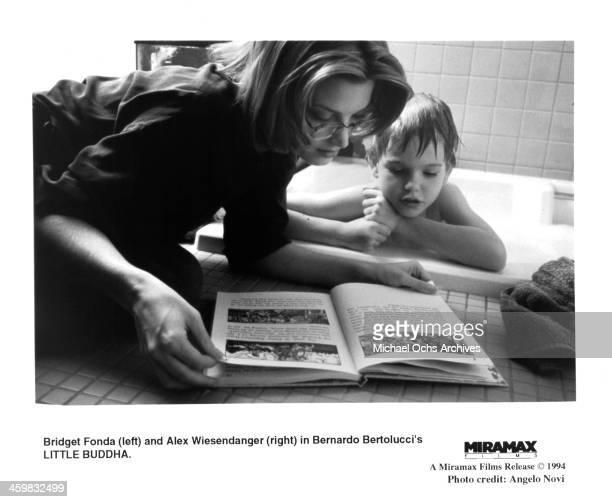 "Actress Bridget Fonda and actor Alex Wiesendanger on the set of the Miramax Film movie ""Little Buddha"" circa 1993."