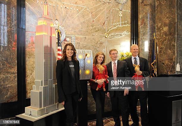 Actress Bridget Moynahan, author Anna Dewdney, Jumpstart COO Paul Leech and Chairman of U.S. Higher Education for Pearson Bill Barke attend the...