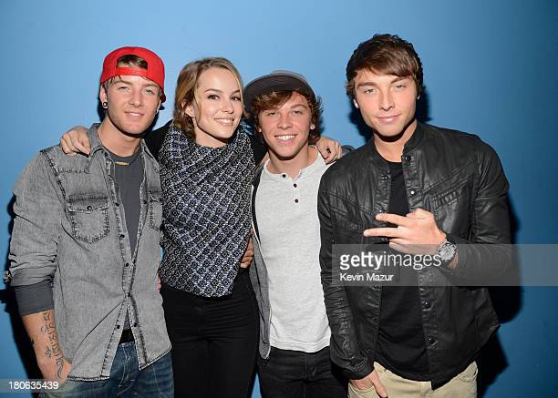 Actress Bridgit Mendler poses with the band Emblem3 at the TJ Martell Foundation's 14th Annual Family Day Honoring Paradigm Talent Agency's Marty...
