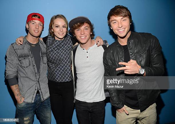 """Actress Bridgit Mendler poses with the band Emblem3 at the """"T.J. Martell Foundation's 14th Annual Family Day Honoring Paradigm Talent Agency's Marty..."""