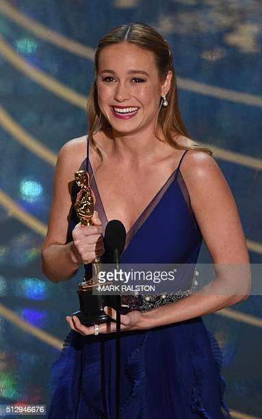 Actress Brie Larson accepts her award for Best Actress Room on stage at the 88th Oscars on February 28 2016 in Hollywood California AFP PHOTO / MARK...