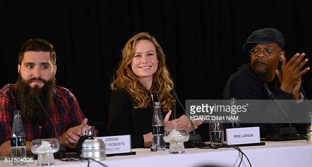 Actress Brie Larson director Jordan VogtRoberts and actor Samuel L Jackson react during a press conference for the Vietnam location filming of 'Kong...