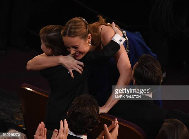 Actress Brie Larson hugs actor Jacob Tremblay before accepting the award for Best Actress in Room at the 88th Oscars on February 28 2016 in Hollywood...