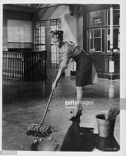 Actress Brigitte Bardot sweeping the floor in a scene from the film 'Babette Goes to War' 1959