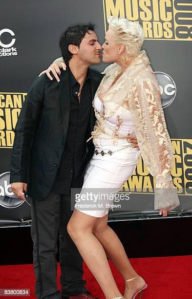 Actress Brigitte Nielsen and husband Mattia Dessi arrive at the 2008 American Music Awards held at Nokia Theatre LA LIVE on November 23 2008 in Los...